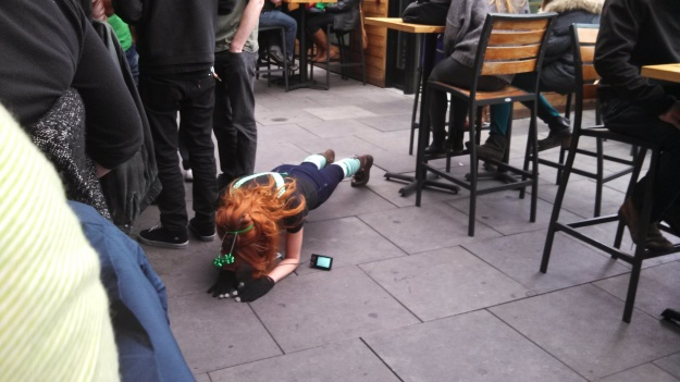 Young lady doing push-ups randomly at Jack Rose's St. Patrick's Day Celebration