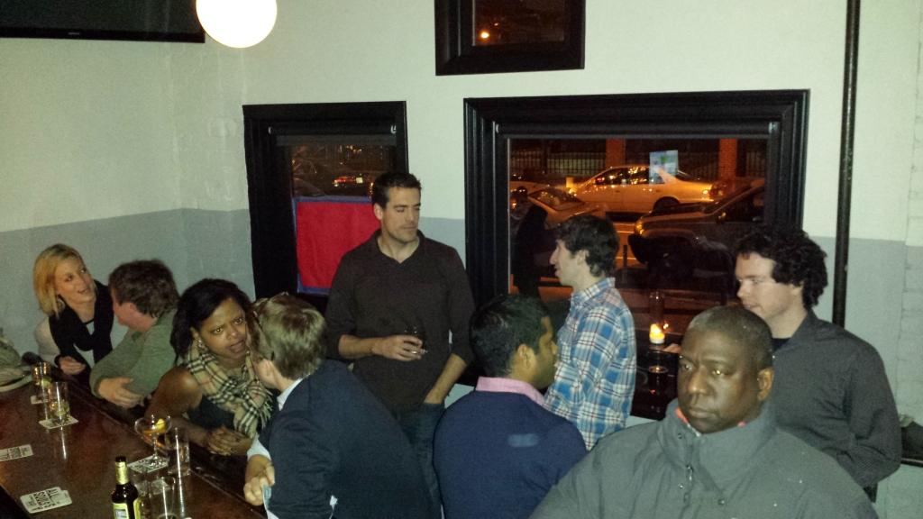 Shrawlers conversing in the corner of a corner bar
