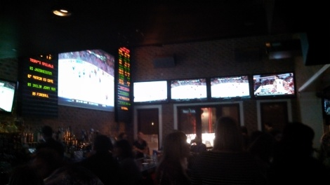 Main bar area with ticker and huge projection