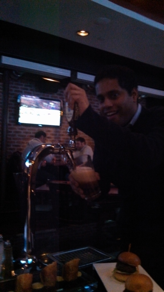 Pouring own beer! Also, some of the great food served.