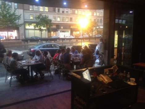 Folks enjoying new patio from open air front area