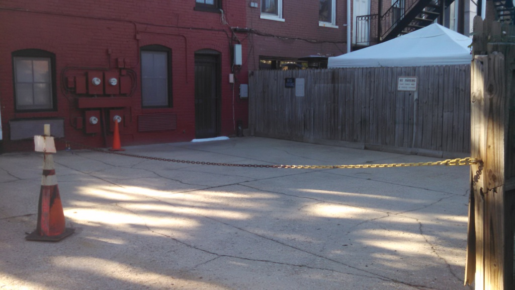 Another view of back patio. Bar Charley's patio is covered by white tent